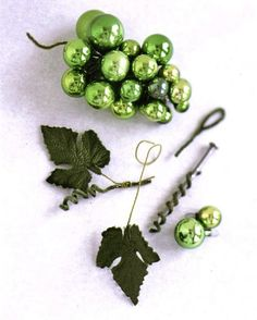 Make a beautiful grape cluster out of tiny Christmas Tree Ornaments!