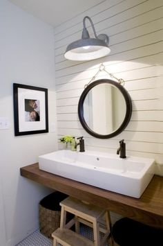 Sweet bathroom idea. horizontal wood paneling. round mirror. double sink. galvanized sconce. so simple.