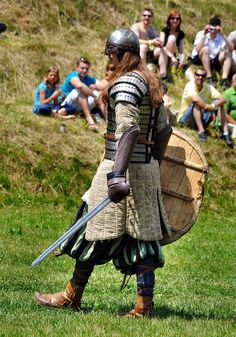 Viking warrior. Lamellar lorica segmentata over a longsleeved quilted gambeson, with a spectacled helm.