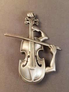 """Vintage JJ Silver Toned Pewter Violin and Arm Brooch.  Measures about 2 1/2"""" Tall"""