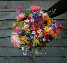 This is too big, but I LOVE this wildflower bouquet! Bouquet comprised poppy, muscari, daisy, green bell, clematis, David Austin roses, garden roses, sunflower, narcissi, guelder rose, bluebell, sunflower, jasmine, snapdragon, tulip, forget me not and delphinium, and was bound with jade ribbon and a holding cross.