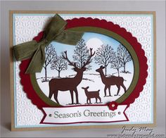 handmade Christmas card by Judy May ... framed oval with winter scene ... Lovely as a tree and die cut deer ... great card! ... Stampin' Up!