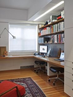 I like having two work stations against one wall to free up the space, with storage above.