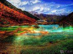 Jiuzhaigou Valley, northern Sichuan, China Stretching over 180,000 acres this locations is known for its Tibetan villages and multi-level waterfalls with colorful lakes that provide crystal clear views of the bottom.  http://i1.w.hjfile.cn/doc/201205/19fd8833200a49278a1b96ca507000b6.jpg