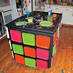 Retro 80s party ideas for table skirting to look like rubik's cube.