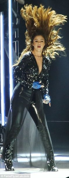 Hair-raising: The star channelled Beyonce as she performed in front of a powerful wind machine while throwing her hair back and forth
