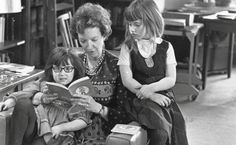 Madeleine L'Engle reads to her granddaughters.