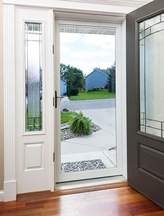 Storm doors never looked so good. Larson Storm Doors are functional and enhance curb appeal. View our photo gallery and get inspired. Modern Front Door, House Front Door, Front Entry, Front Porch, Front Door Paint Colors, Painted Front Doors, City Farmhouse, Farmhouse Front, Front Storm Door Ideas