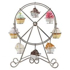 """Nickel-plated cupcake holder in a ferris wheel shape. Holds eight cupcakes.  Product: Cupcake holderConstruction Material: Nickel-plateColor: Shiny silverFeatures:  Holds eight cupcakesRemovable holdersFerris wheel design Dimensions: 18.75"""" H x 13.5"""" W x 7.75"""" D Cleaning and Care: Wipe with soft cloth ADORABLE!!"""