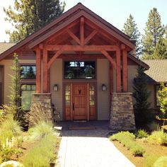 Timber Frame home.... Love the front entrance way....