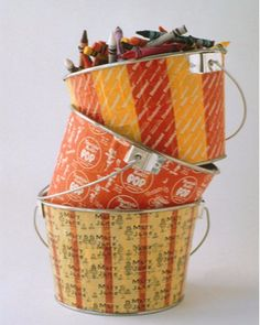 Candy-Wrapper Buckets | Martha Stewart Living - Tin paint buckets become something else entirely when they're decoupaged with Halloween-candy wrappers, especially some of the older, prettier ones -- like Mary Janes, which have a vintage charm.