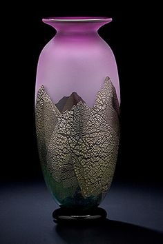 Mountainscape Vase  Multiple layers of glass color to create the colorful landscape of mountains.    Hand blown glass vase by Bernard Katz. Shown in Reddish Amethyst & layered with Gold and Silver leaf.