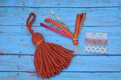 A gorgeous autumn theme kit consisting of a ribbon paper clip, a beautiful fall color tassel (1 has a ribbon trim and the other 2 autumn