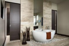 Looking to modernize your home? Try installing pocket #interiordoors in your bathroom that not only look gorgeous, but also save space. Learn more on updating the aesthetic appeal of your home: http://www.jeld-wen.com/planning-projects/projects/replacing-interior-doors