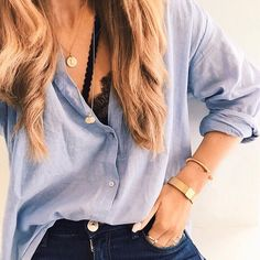 Button down with gold jewelry and a peek-a-boo lace bra.