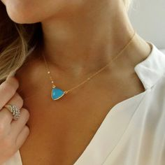 Tiny gold turquoise necklace on a gold filled chain... love this dainty look