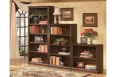 "The Hamlyn 30"" Bookcase from Ashley Furniture HomeStore (AFHS.com). With rich traditional style infused with a European flair, the sophisticated elegance of the ""Hamlyn"" home office collection is sure to enhance the beauty of any home office decor."