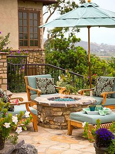 Gather 'Round the Fire... Soft outdoor furniture and a matching patio umbrella make the space even more inviting.