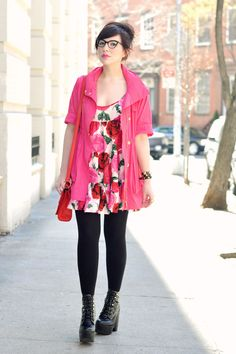 I love how the vibrant pink jacket goes so well with the girly, floral-print babydoll doll and the incorporation of quirky accessories like the 90's-style boots in an inspired choice.