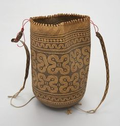 Object Name: Basket Place Made: Asia: South East Asia, Malaysia, Borneo, Sarawak People: Iban Period: Mid 20th century Date: 1940 - 1970 Dimensions: L 30 cm x W 55 cm Materials: Rattan; grass Techniques: Basket woven; plaited; braided
