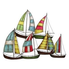 Group of metal sculpted sailboats. Measures 32 inches wide and 26 inches high.