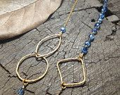 Long necklace with blue kyanite and gold plated silver hoops