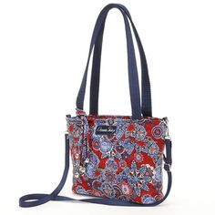 This Donna Sharp bag is the perfect way to make a fashion statement while you're on the go. The tote design, with a reinforced sturdy bottom, features carrying handles and pockets. Show off your savvy style with this fabulous bag.Interior fabric patterns may vary from images shown.