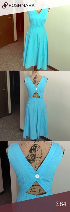 💙Tiffany Blue Dress💙 Beautiful brand new London Times button dress! Has a very sexy keyhole in the mid back! Cut perfectly since you can still wear a bra with it. It is a below the knee dress. It is brand new with tags and a replacement button just in case😊 London Times Dresses Midi