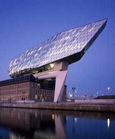 World Architecture Community News - Zaha Hadid Architects crowns Belgium's historic Antwerp Port Building with a floating glazed tower Zaha Hadid Architecture, Amazing Architecture, Contemporary Architecture, Architecture Design, Innovative Architecture, Architecture Office, Zaha Hadid Design, Arquitetos Zaha Hadid, Architectes Zaha Hadid