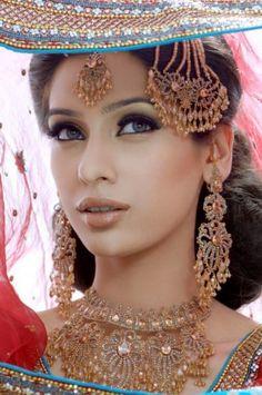 Beautiful Pakistani Brides with a hat.
