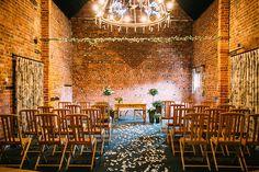 Curradine Barns set up for a wedding ceremony - Wedding Advice | Real Brides Wedding Tips | Curradine Barns