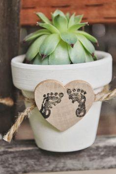 Sources: diaper cake, onesies cupcakes, lid birdcages, diaper truck, clothesline, baby jars, plant favors, foot print succulent,