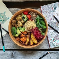 """Food and doodles  Another Buddha bowl because that's how I rowl  Baked potatoes and sweet potatoes quinoa tamari marinated tofu avocado hummus greens and beet sprouts. Know why it's called a Buddha bowl? The common explanation is that the bowl so packed with food that it has a rounded top - just like Buddhas belly. I'm more into the explanation of Ōryōki - a zen-Buddhist way of eating meaning """"just enough"""". The Buddhists carry a collection of bowls and utensils where the biggest bowl is…"""