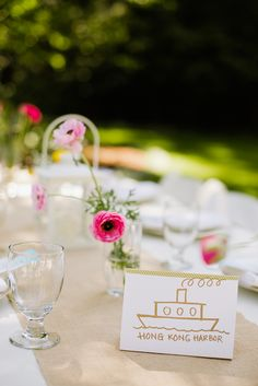 We love the color and simplicity of this elegant tablescape. No need to go for big bouquets: Just a few small flowers tucked in a clear vase can provide just the punch of color your wedding needs.   - ELLEDecor.com