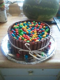 My husband birthday cake. kit kat sides with a m&m pool. Hindsight 20/20 note:  kids loved all the chocolate, but was way too much sugar in one setting for the adults.