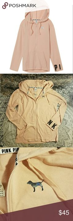 VS PINK side slit full zip hoodie peach cream S New with tags vs pink perfect full zip hoodie with side slits. Has front pockets, one wrist area has pink written in black letters. It also has a shimmery dog near the top. Made of a soft cotton blend. Color is like a light pink / cream shade. Sells for $55 in store. No trades. I consider offers. PINK Victoria's Secret Tops Sweatshirts & Hoodies