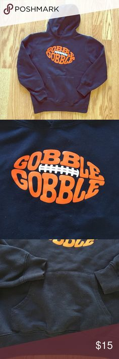 "Boys hoodie size 7 ""Gobble Gobble"" thanksgiving hoodie size 7. Super cute and perfect for the holidays!! Navy blue with orange lettering. Excellent used condition. Shows slight signs of wear but no holes, rips or loose seams. Bought of Zulily last year for $28. All my items come from a smoke free home. I offer bundling discounts so check out my closet. Happy Poshing! Shirts & Tops Sweatshirts & Hoodies"