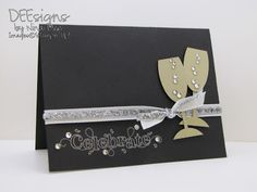 black cardstock is a classy background for this handmade new years card silver ink on