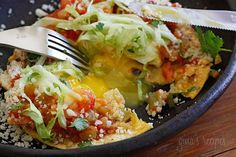 Huevos Rancheros - golden egg yolks mingle with tomatoes, green chiles and cheese over a crispy corn tortilla for breakfast (or dinner)… what can be better!