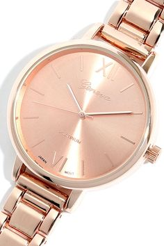 """You will treasure every passing minute spent wearing our Hour Love Rose Gold Watch! This chic timepiece has an oversized boyfriend watch look, with a round rose gold face plate accented with matching time markers and hands. Shiny links form a classic band. Face measures 1.5"""" in diameter, plus a 6.5"""" band with folding clasp closure."""