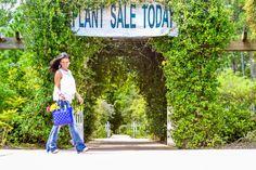 Flare jeans. Plant sale, garden. Flowers. Leaves. Botanical garden