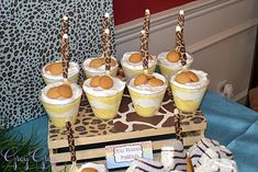 Love the banana pudding idea, with spoons wrapped in leopard print crepe paper. Cute crate from hobby lobby.  See all the detail of this Jungle Safari theme: http://www.greygreydesigns.com/2011/02/bretts-jungle-safari-1st-birthday-party.html