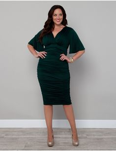 Obsessed with this ruched emerald green holiday inspired dress!