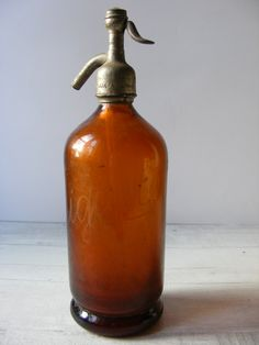 Rare Antique  French amber SELTZER BOTTLE, mouth blown,1900s, via Etsy.