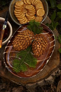 Almond Acorns. Almonds and cream cheese for crackers at the baby shower look complete with evergreen branches as a garnish.