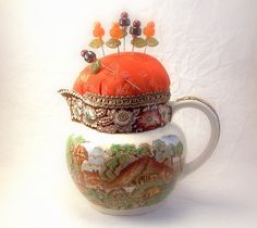 Vintage English creamer pincushion Autumn colors ceramic porcelain china fall bittersweet orange decorative pins sewing room TAGT tenX. $19.95, via Etsy.