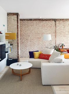 Montreal apartment living room with MDF Italia shelves and custom sofa with Hay cushions