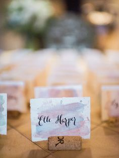 Watercolor cork escort cards: http://www.stylemepretty.com/2015/11/04/romantic-summer-wedding-at-zenith-vineyard/ | Photography: Alexandra Grace - http://alexgracephotography.com/hy.com
