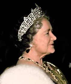 Queen Elizabeth the Queen Mother wearing the Greville emerald necklace (probably made for Queen Marie Antoinette) and earrings and the Boucheron honeycomb tiara (also from the Greville bequest).