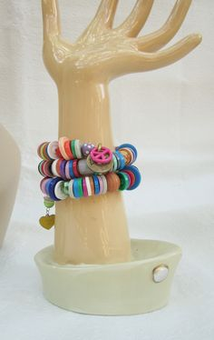 This colorful bracelet is made from the flip tops off of medication vials. I am a nurse and just CANNOT throw these away!